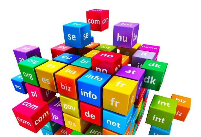 Creative abstract global internet communication PC technology and web telecommunication business computer concept: group of color cubes with domain names isolated on white background